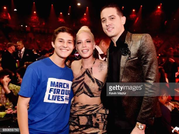 Alex Moscou Halsey and GEazy attend the 2018 iHeartRadio Music Awards which broadcasted live on TBS TNT and truTV at The Forum on March 11 2018 in...
