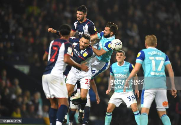 Alex Mowatt and Robert Snodgrass of West Bromwich Albion are challenged by Graeme Shinnie of Derby County during the Sky Bet Championship match...