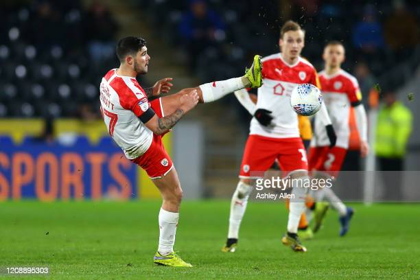 Alex Mowatt of Barnsley FC brings the ball down during the Sky Bet Championship match between Hull City and Barnsley at KCOM Stadium on February 26...