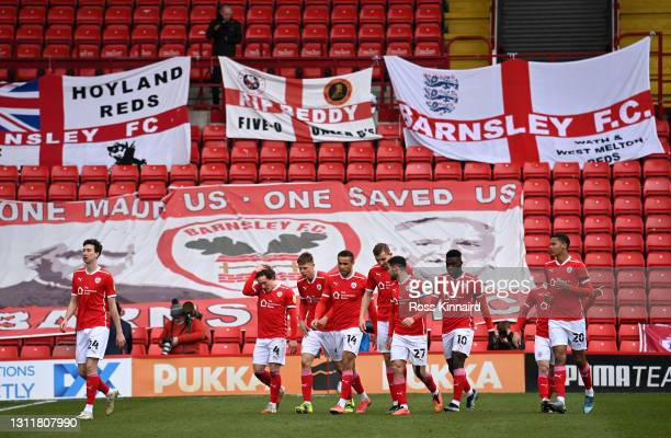 Alex Mowatt of Barnsley FC celebrates with teammates after scoring their team's first goal during the Sky Bet Championship match between Barnsley and...