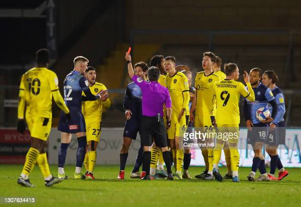 Alex Mowatt of Barnsley FC is shown a red card and sent off by Match Referee, Darren Bond during the Sky Bet Championship match between Wycombe...