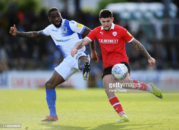 Alex Mowatt of Barnsley is challenged by Abumere Ogogo of Bristol Rovers during the Sky Bet League One match between Bristol Rovers and Barnsley at...