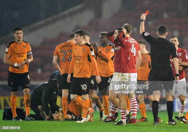 Alex Mowatt of Barnsley is shown a red card after he fouled Jack Price of Wolverhampton Wanderers during the Sky Bet Championship match between...
