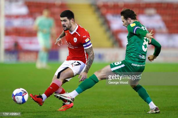 Alex Mowatt of Barnsley passes the ball whilst under pressure from Alan Browne of Preston North End during the Sky Bet Championship match between...