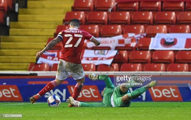 Alex Mowatt of Barnsley scores his team's second goal past Thomas Kaminski of Blackburn Rovers during the Sky Bet Championship match between Barnsley...