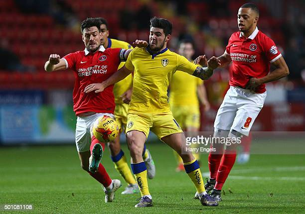 Alex Mowatt of Leeds competes for the ball with Johnnie Jackson of Charlton during the Sky Bet Championship match between Charlton Athletic and Leeds...