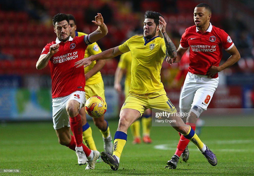 Alex Mowatt of Leeds (C) competes for the ball with Johnnie Jackson of Charlton (L) during the Sky Bet Championship match between Charlton Athletic and Leeds United at The Valley on December 12, 2015 in London, United Kingdom.