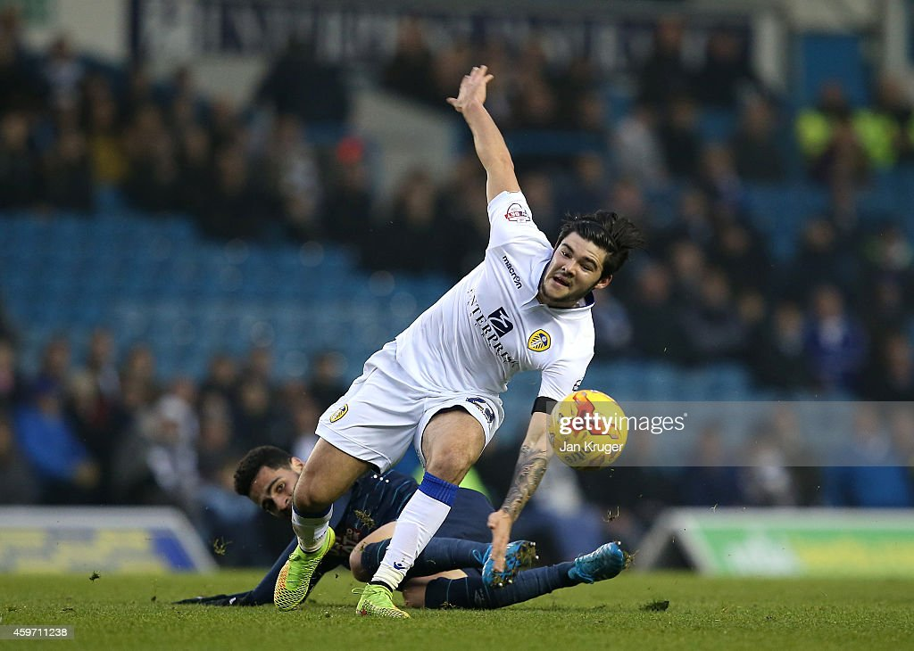 Alex Mowatt of Leeds leaps over the tackle of Omar Mascarell of Derby County during the Sky Bet Championship match between Leeds United and Derby County at Elland Road on November 29, 2014 in Leeds, England.