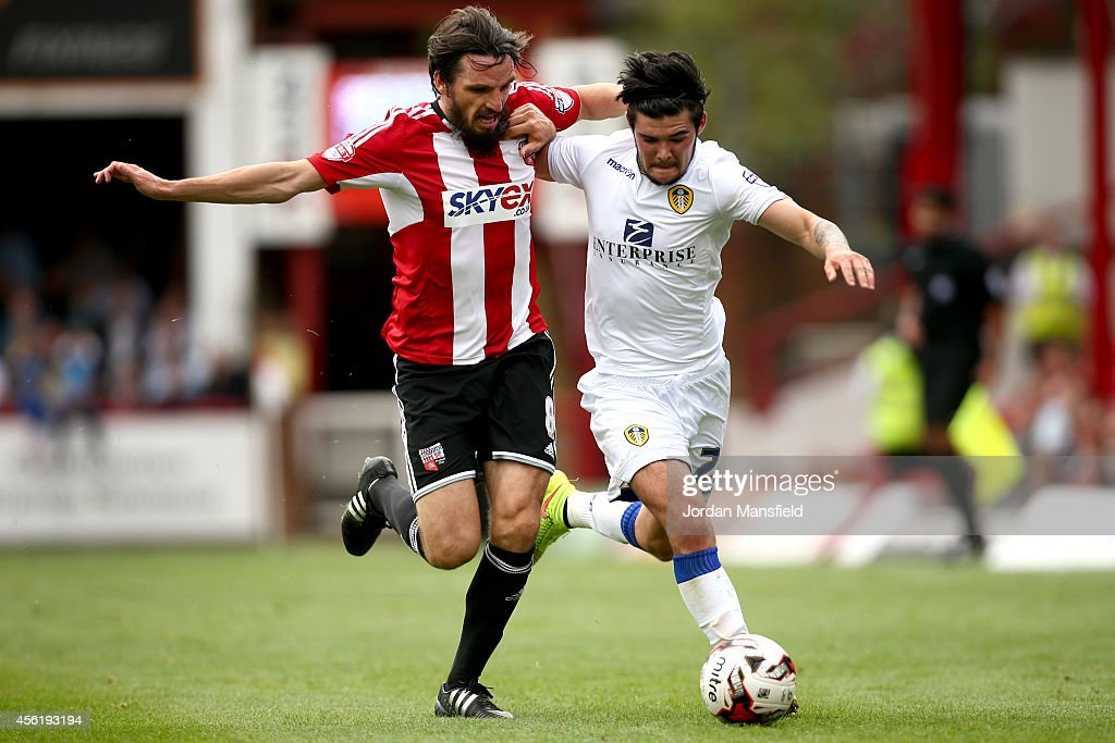 Alex Mowatt (R) of Leeds tackles for the ball with Jonathan Douglas of Brentford during the Sky Bet Championship match between Brentford and Leeds United at Griffin Park on September 27, 2014 in Brentford, England.