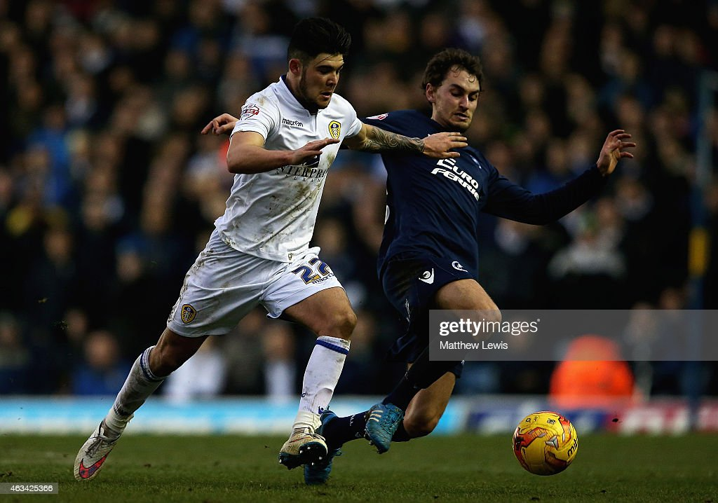 Alex Mowatt of Leeds United and Edward Upson of Millwall challenge for the ball during the Sky Bet Championship match between Leeds United and Millwall at Elland Road on February 14, 2015 in Leeds, England.