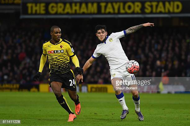 Alex Mowatt of Leeds United and Odion Ighalo of Watford compete for the ball during the Emirates FA Cup fifth round match between Watford and Leeds...