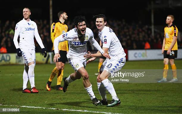 Alex Mowatt of Leeds United celebrates with team mates as he scores their second goal during the Emirates FA Cup Third Round match between Cambridge...