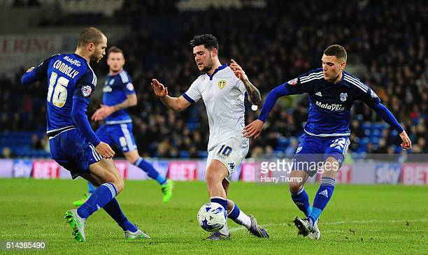 Alex Mowatt of Leeds United is tackled by David Connolly of Cardiff City and Stuart O'Keefe of Cardiff City during the Sky Bet Championship match...