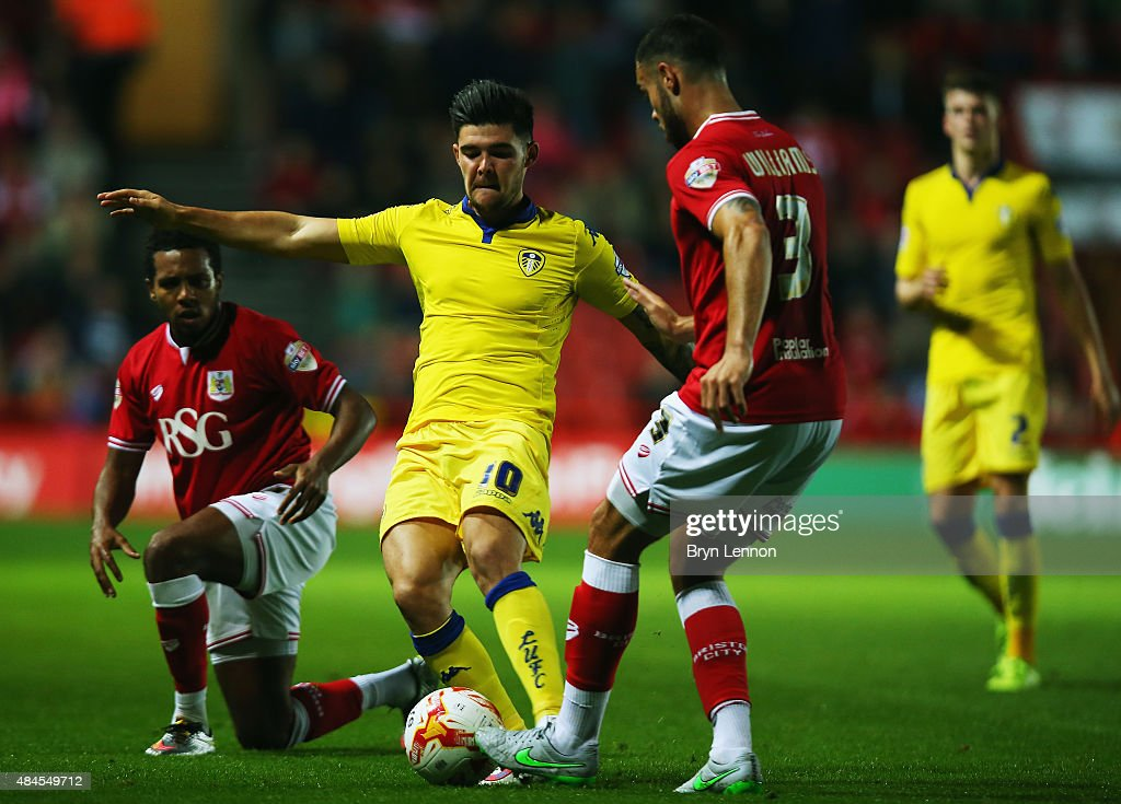 Alex Mowatt of Leeds United is tackled by Derrick Williams of Bristol City during the Sky Bet Championship match between Bristol City and Leeds United at Ashton Gate on August 19, 2015 in Bristol, England.