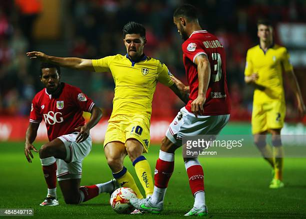 Alex Mowatt of Leeds United is tackled by Derrick Williams of Bristol City during the Sky Bet Championship match between Bristol City and Leeds...