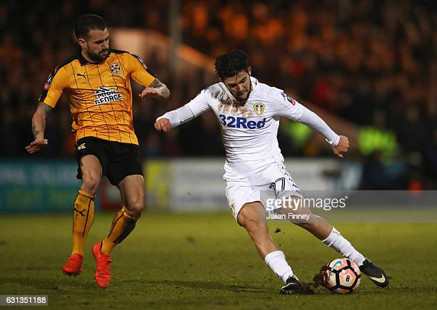 Alex Mowatt of Leeds United shoots as James Dunne of Cambridge United moves in to challenged during the Emirates FA Cup Third Round match between...