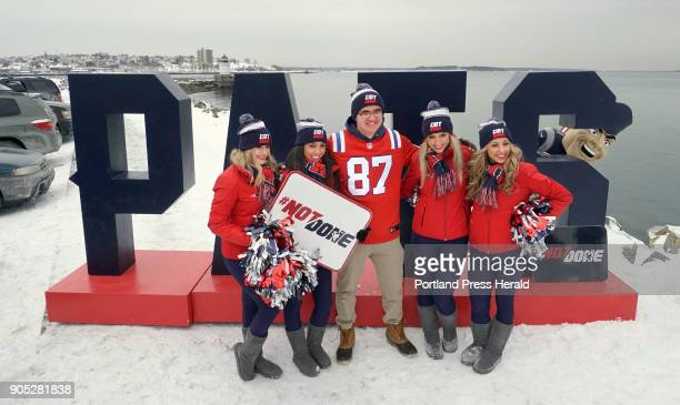 Alex Mukai of Cape Elizabeth poses for a photo with New England Patriots cheerleaders from left Kelsey Cornwell Adrena Santorsola Alex Brandy and...