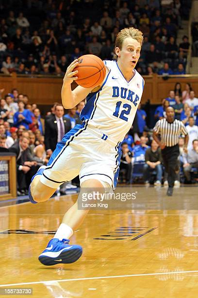 Alex Murphy of the Duke Blue Devils drives toward the hoop against the WinstonSalem State Rams at Cameron Indoor Stadium on November 1 2012 in Durham...