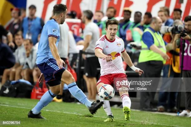 Alex Muyl of New York Red Bulls challenged by RJ Allen of New York City FC during the New York Red Bulls Vs New York City FC MLS regular season match...