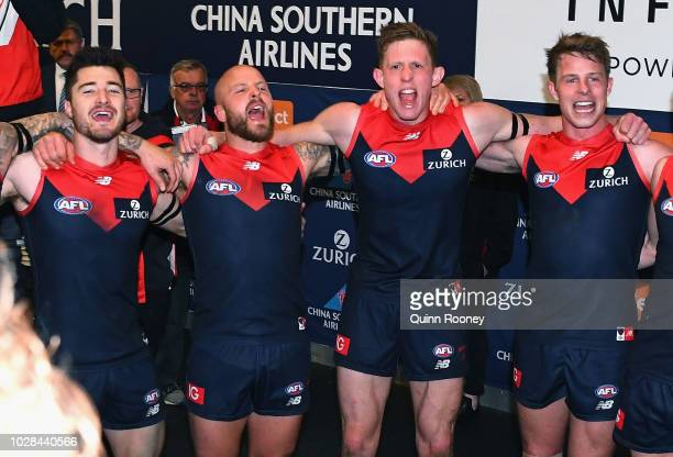 Alex NealBullen Nathan Jones Sam Frost and Mitch Hannan of the Demons sing the song in the rooms after winning the AFL First Elimination Final match...