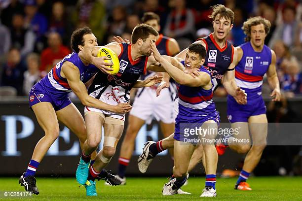 Alex Neal-Bullen of Casey is tackled during the VFL Grand Final match between the Casey Scorpions and the Footscray Bulldogs at Etihad Stadium on...