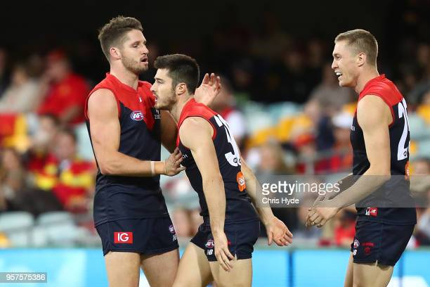 Alex NealBullen of the Demons celebrates a goal during the round eight AFL match between the Gold Coast Suns and the Melbourne Demons at The Gabba on...