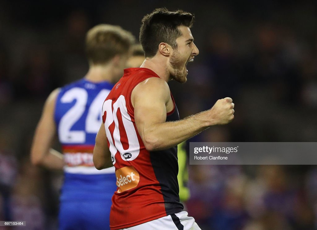 Alex Neal-Bullen of the Demons celebrates after scoring a goal during the round 13 AFL match between the Western Bulldogs and the Melbourne Demons at Etihad Stadium on June 18, 2017 in Melbourne, Australia.