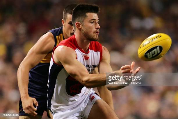 Alex NealBullen of the Demons handpasses the ball under pressure from Liam Duggan of the Eagles during the round 14 AFL match between the West Coast...