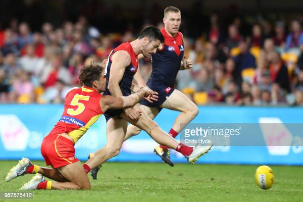 Alex NealBullen of the Demons kicks a goal during the round eight AFL match between the Gold Coast Suns and the Melbourne Demons at The Gabba on May...