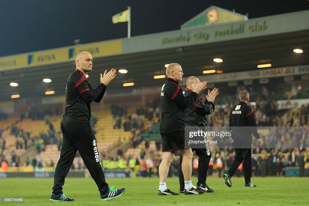 Alex Neil, Manager of Norwich City applauds supporters following relegation during the Barclays Premier League match between Norwich City and Watford at Carrow Road on May 11, 2016 in Norwich, England.