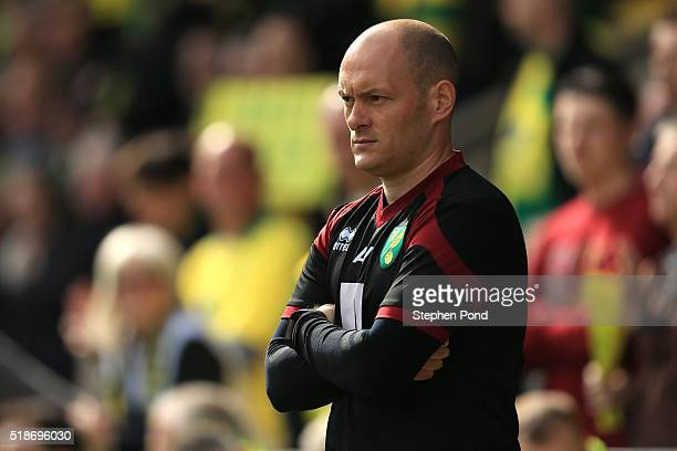 Alex Neil Manager of Norwich City looks on prior to the Barclays Premier League match between Norwich City and Newcastle United at Carrow Road on...