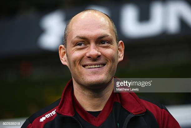 Alex Neil manager of Norwich City smiles during the Barclays Premier League match between Tottenham Hotspur and Norwich City at White Hart Lane on...