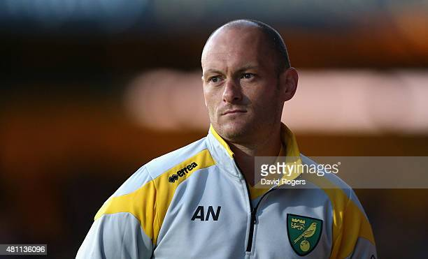 Alex Neil the Norwich City manager looks on during the pre season friendly match between Cambridge United and Norwich City at the Abbey Stadium on...