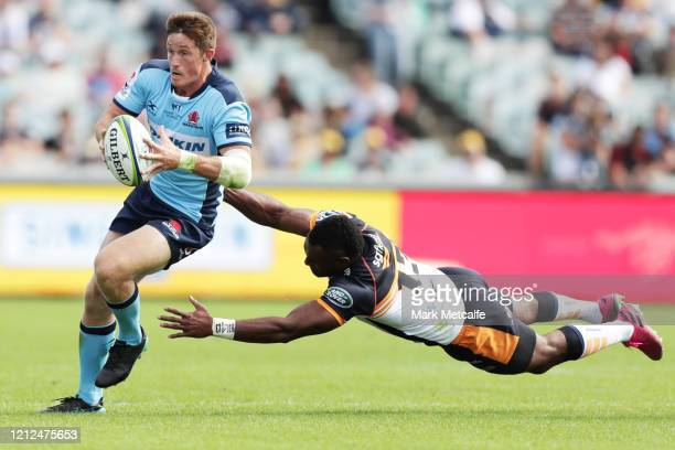 Alex Newsome of the Waratahs evades the tackle of Tevita Kuridrani of the Brumbies during the round seven Super Rugby match between the Brumbies and...