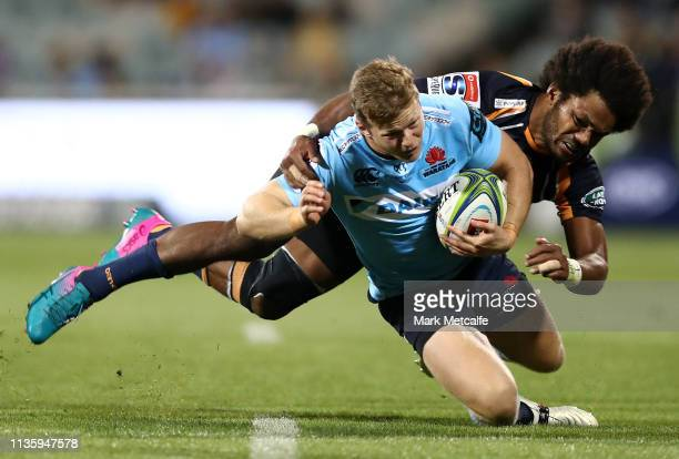 Alex Newsome of the Waratahs Is tackled by Henry Speight of the Brumbies during the round five Super Rugby match between the Brumbies and the...