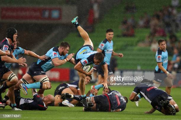 Alex Newsome of the Waratahs is tackled during the round 3 Super Rugby match between the Rebels and the Waratahs at AAMI Park on February 14 2020 in...