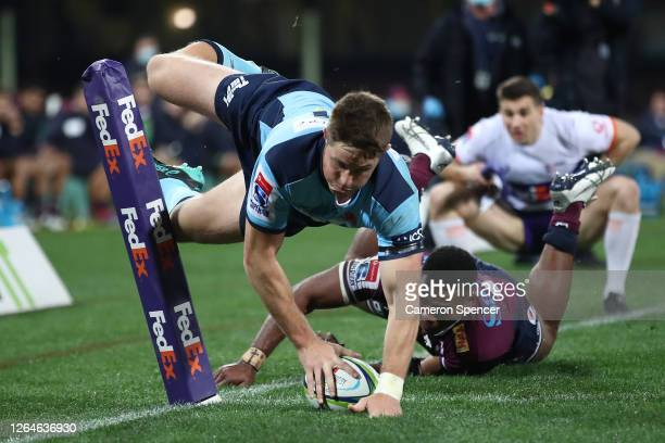 Alex Newsomeof the Waratahsscores a try during the round six Super Rugby AU match between the Waratahs and the Reds at Sydney Cricket Ground on...