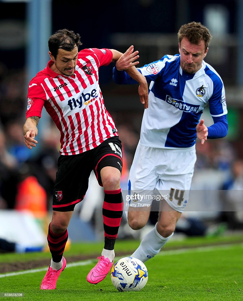 Alex Nicholls of Exeter City is tackled by Chris Lines of Bristol Rovers during the Sky Bet League Two match between Bristol Rovers and Exeter City at the Memorial Stadium on April 23, 2016 in Bristol, England.