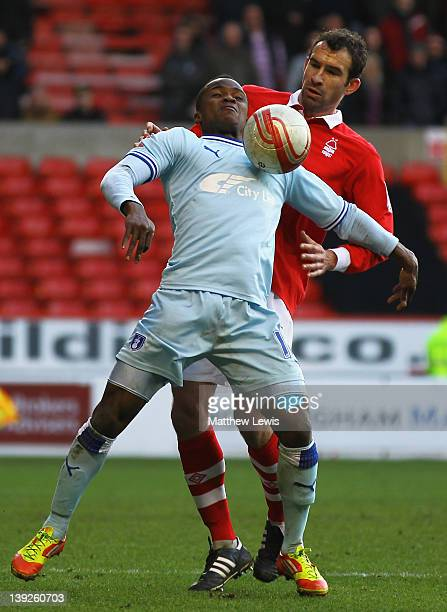 Alex Nimely of Coventry and Danny Higginbotham of Nottingham challenge for the ball during the npower Championship match between Nottingham Forest...