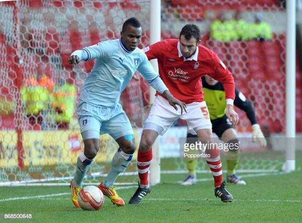 Alex Nimely of Coventry City and Danny Higginbotham of Nottingham Forest in action during a Npower Championship match at the City Ground on February...