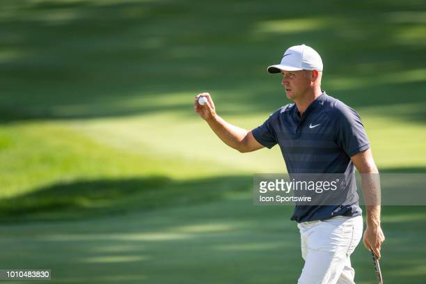 Alex Noren acknowledges the crowd after his putt on the 16th green during the second round of the WGCBridgestone Invitational on August 3 2018 at the...