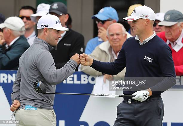 Alex Noren and David Lingmerth of Sweden celebrate during day one of the World Cup of Golf at Kingston Heath Golf Club on November 24 2016 in...