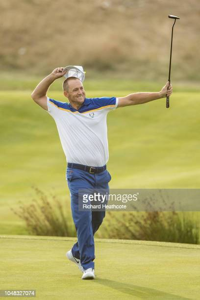 Alex Noren celebrates holing a long putt on the 18th green to win his match during singles matches of the 2018 Ryder Cup at Le Golf National on...