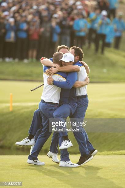 Alex Noren is congratulated by Thorbjorn Olsen Tyrrell Hatton and Francesco Molinari as he wins on the 18th green during singles matches of the 2018...