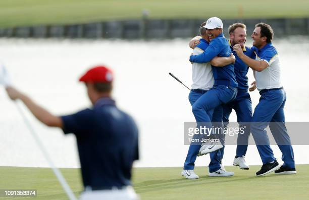 Alex Noren is swamped by European teammates Olesen Hatton and Molinari after he holed a huge putt on the 18th green to beats Bryson deChambeau who is...