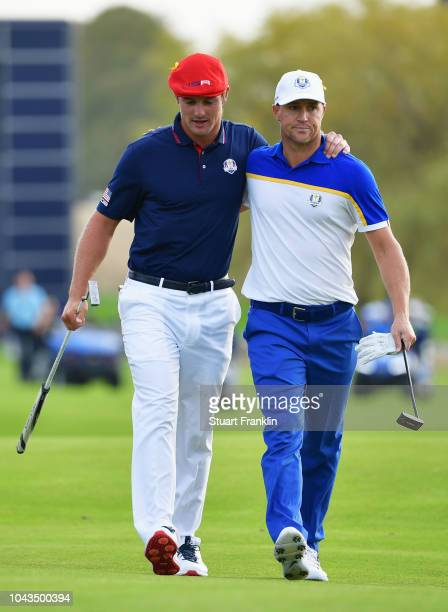 Alex Noren of Europe and Bryson DeChambeau of the United States on the 18th green during singles matches of the 2018 Ryder Cup at Le Golf National on...