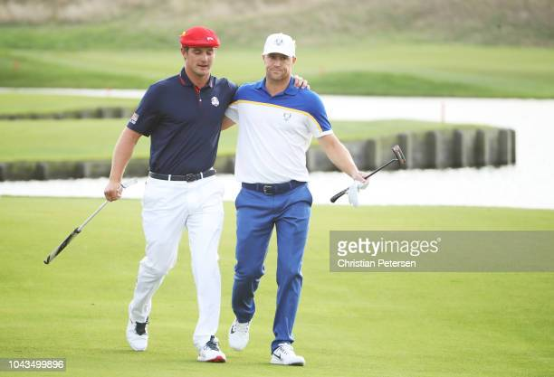 Alex Noren of Europe and Bryson DeChambeau of the United States walk to the 18th green during singles matches of the 2018 Ryder Cup at Le Golf...