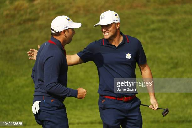 Alex Noren of Europe and Sergio Garcia of Europe celebrate during the afternoon foursome matches of the 2018 Ryder Cup at Le Golf National on...