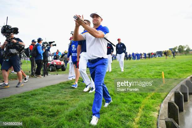 Alex Noren of Europe celebrates after winning The Ryder Cup during singles matches of the 2018 Ryder Cup at Le Golf National on September 30 2018 in...