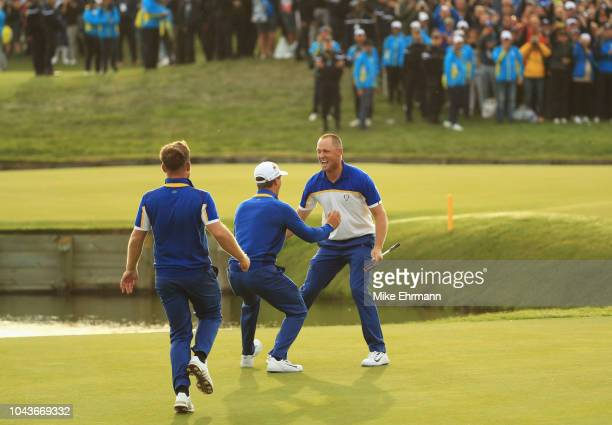 Alex Noren of Europe celebrates winning his match on the 18th green with Thorbjorn Olesen as Europe win The Ryder Cup during singles matches of the...